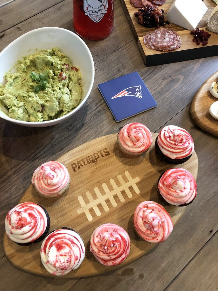 Party food set out on NFL Homegate boards featuring the New England Patriots