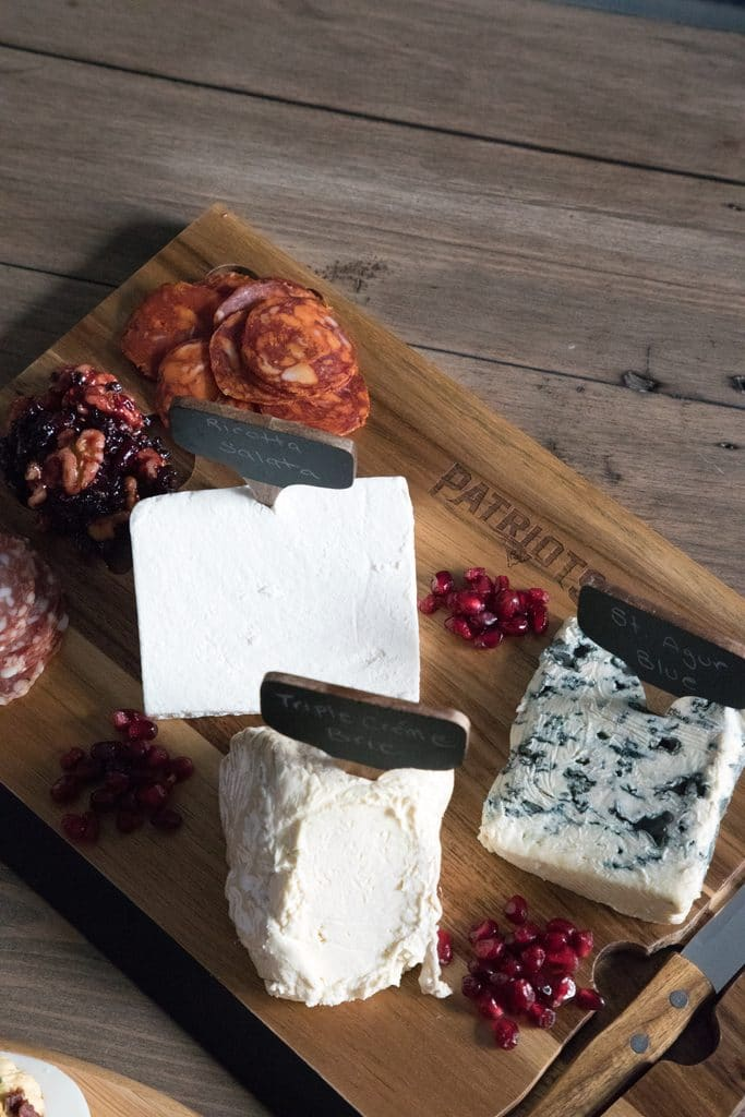 Cheese set out on NFL Homegate boards featuring the New England Patriots