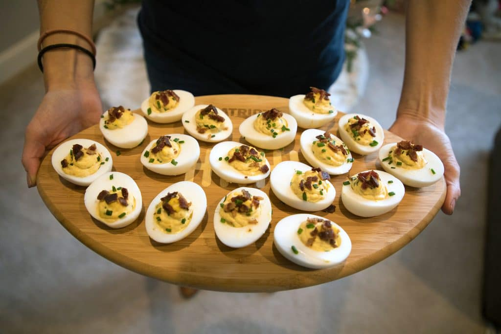 Deviled eggs on a New England Patriots NFL Homegating football-shaped candy board
