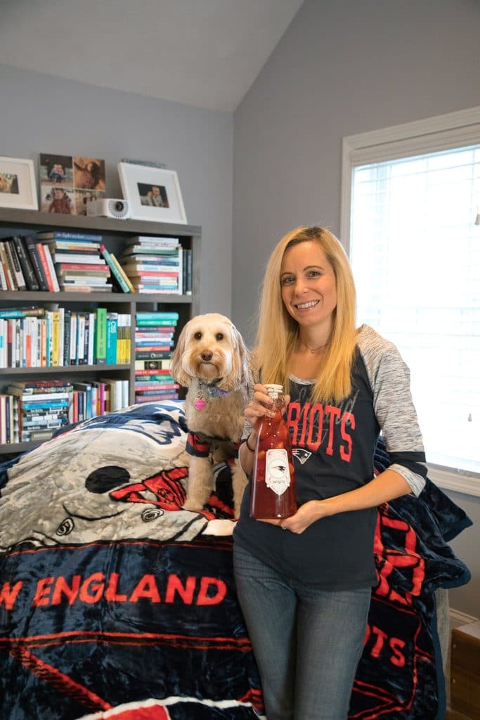 Sues and Winnie the Labradoodle showing off New England Patriots NFL Homegate gear