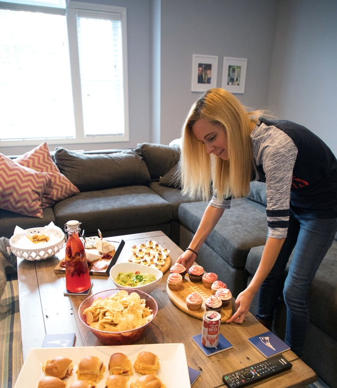 Sues setting out food for her NFL Homegate party