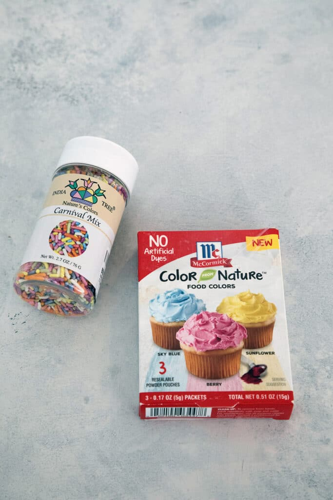 Bottle of naturally colored sprinkles and box of naturally colored food dye