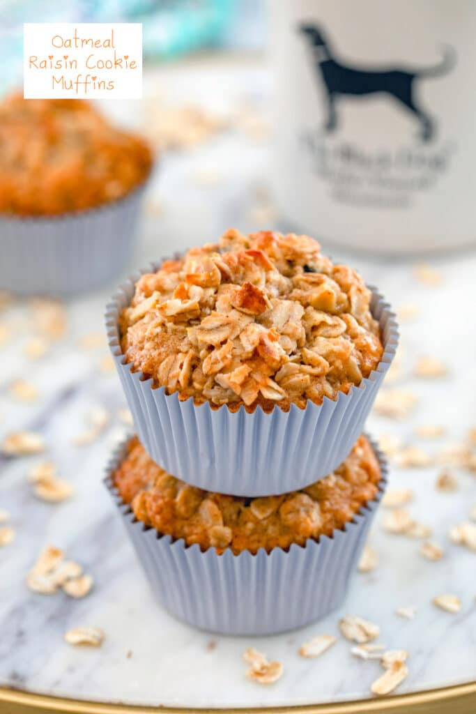 Close-up view of two oatmeal raisin cookie muffins stacked on each other with oats and a mug of coffee in the background and recipe title at top