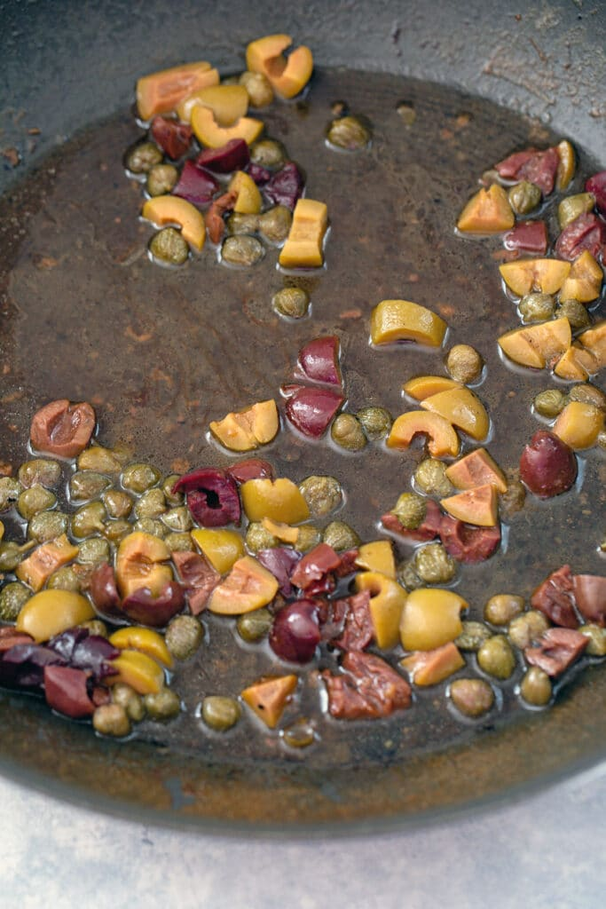 Olives and capers in wine sauce