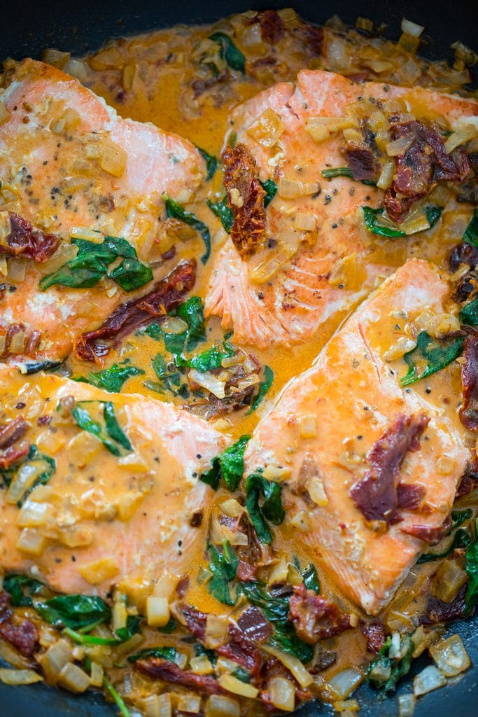 One-Pan Creamy Chipotle Salmon -- An easy-to-make meal packed with chipotle peppers, sun-dried tomatoes, spinach, and a creamy sauce with a little kick | wearenotmartha.com