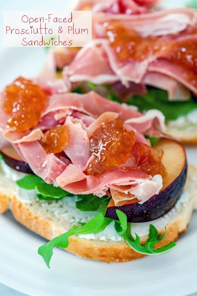 "Up-close view of open-faced prosciutto and plum sandwiches with fig spread drizzled on top and ""Open-Faced Prosciutto and Plum Sandwiches"" text on top"