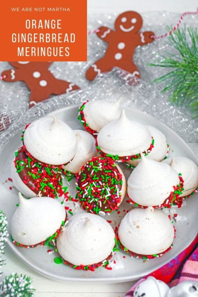 Orange Gingerbread Meringues are an easy-to-make cookie packed with holiday spices and dipped in chocolate   wearenotmartha.com #merginues #meringuerecipe #gingerbread #christmascookies