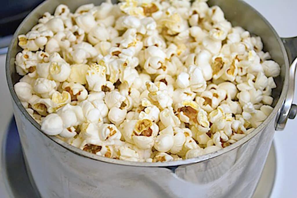 Popcorn popped in saucepan on stovetop