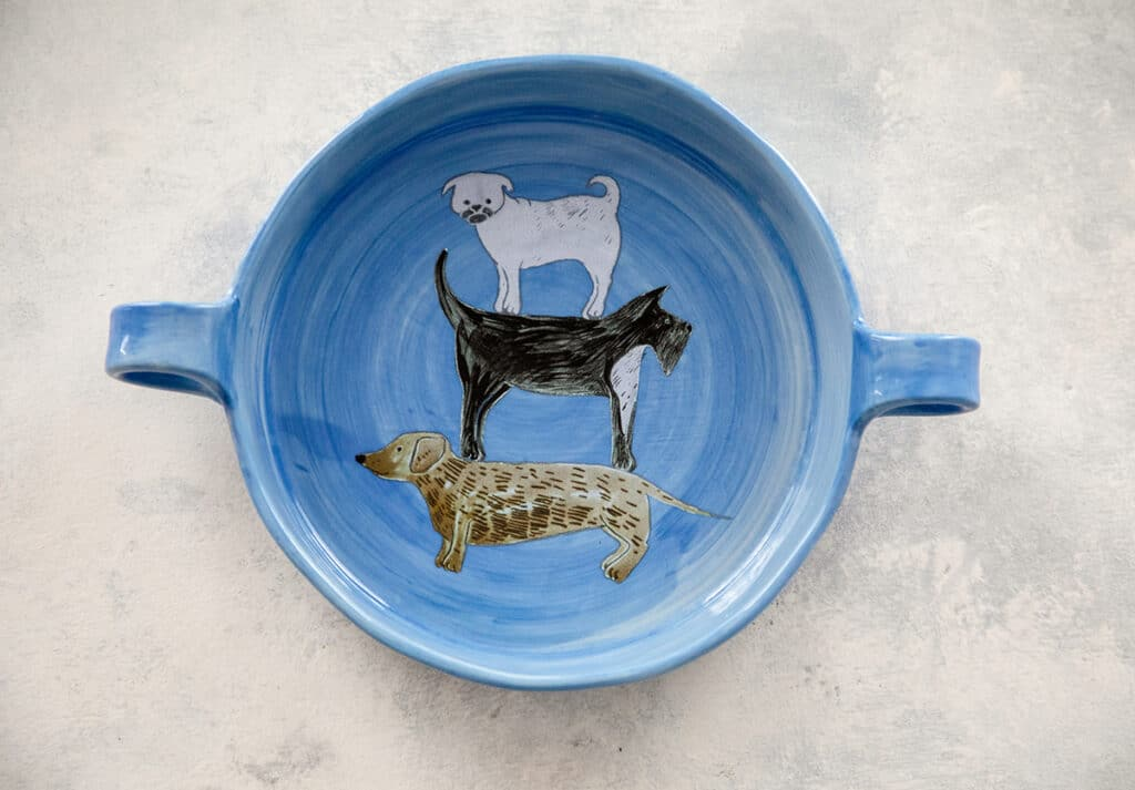 Painted Pup blue pie dish with three dogs standing on each other