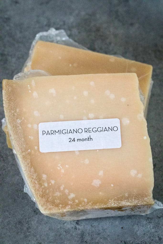 Overhead view of two blocks of parmigiano reggiano