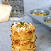 Parmigiano Reggiano Roasted Garlic Mac and Cheese Bites -- These mac and cheese bites are packed with flavor thanks to Parmigiano Reggiano cheese and roasted garlic. They're perfect for serving at parties or for a grab-and-go meal! | wearenotmartha.com #macandcheese #macandcheesebites #partyfood #appetizers #fingerfood #parmesancheese