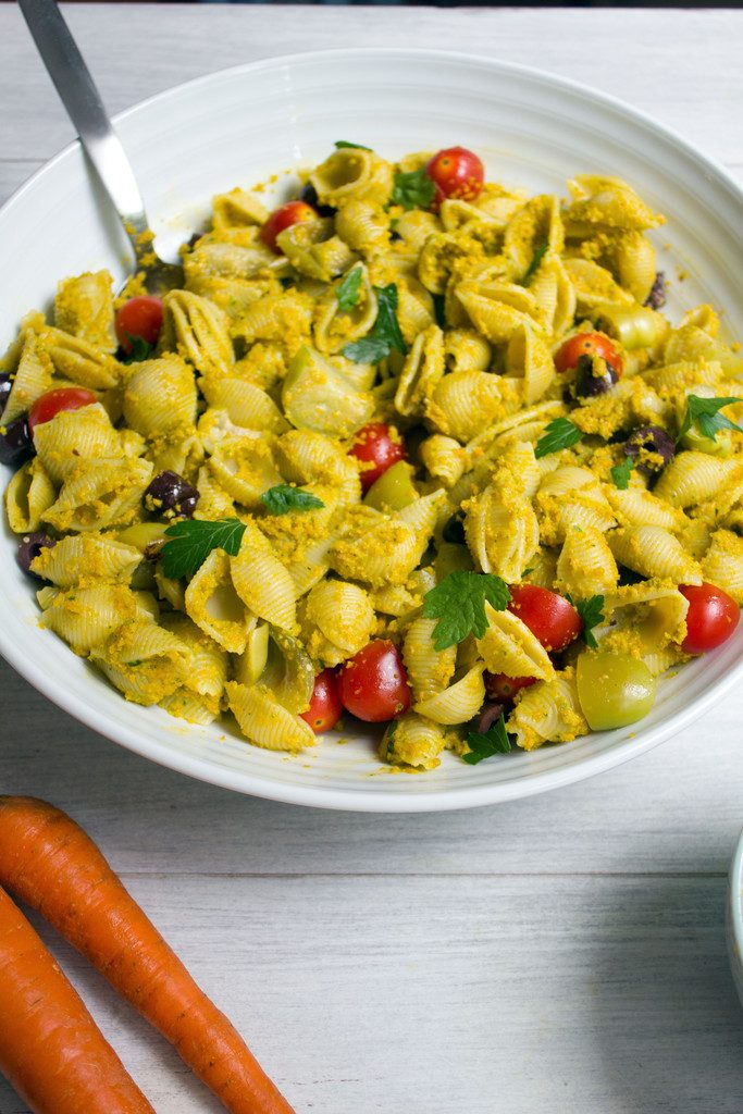 Pasta with Carrot Pesto and Tomatillos -- A new spin on pesto, tossed in pasta with tomatillos, tomatoes, and olives | wearenotmartha.com