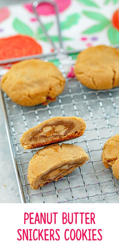 Peanut Butter Snickers Cookies -- These Peanut Butter Snickers Cookies look like a typical peanut butter cookie... But there's a delicious Snickers candy bar surprise inside each one | wearenotmartha.com #cookies #peanutbutter #snickers