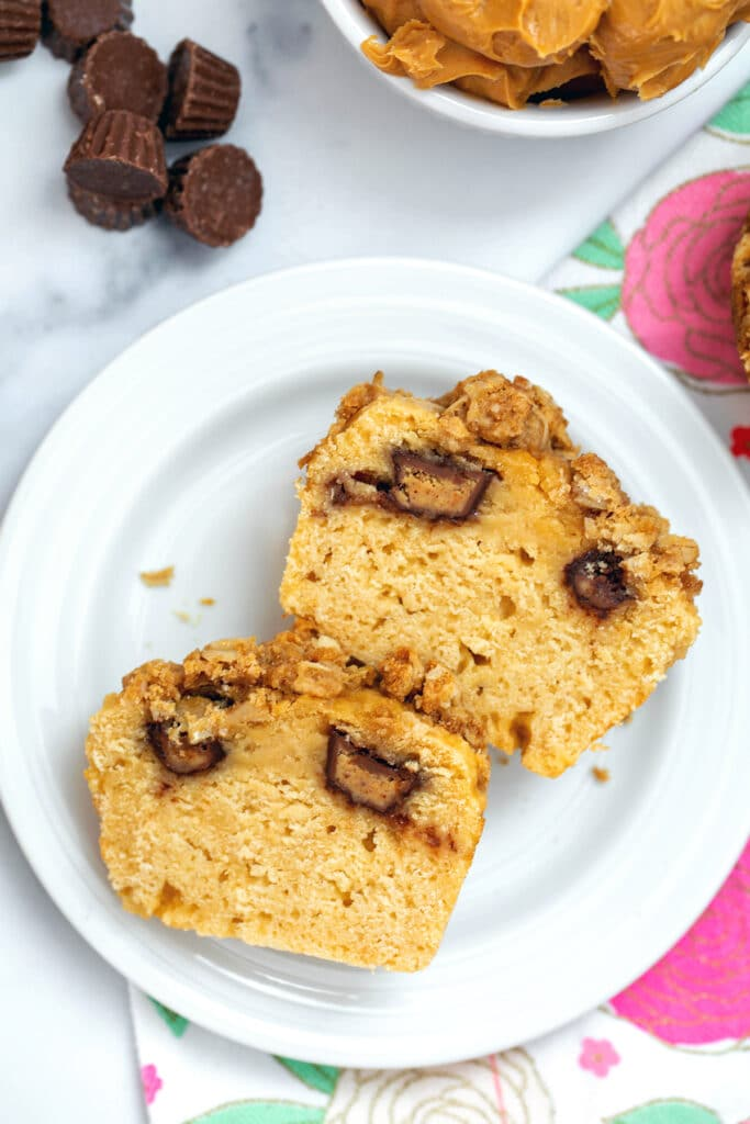 Overhead closeup of a peanut butter chocolate muffin cut in half showing mini peanut butter cup inside
