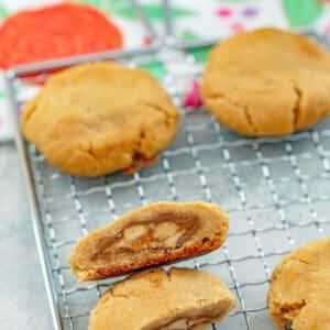 Peanut Butter Snickers Cookies -- These Peanut Butter Snickers Cookies look like a typical peanut butter cookie... But there's a delicious Snickers candy bar surprise inside each one | wearenotmartha.com