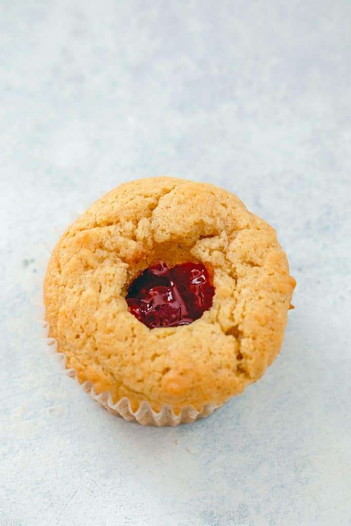 Overhead view of a peanut butter and jelly cupcake with the center cored out and filled with jelly