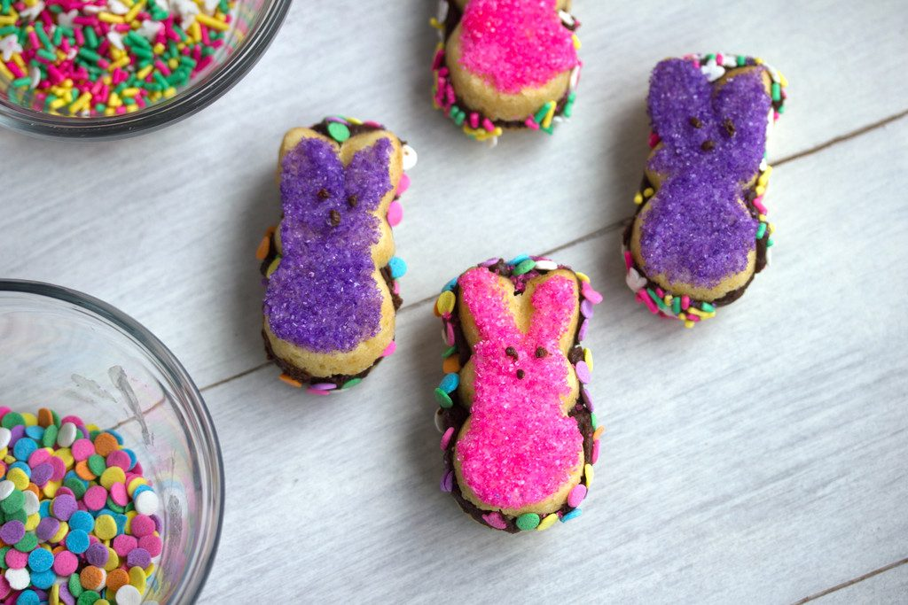 Peeps Fudge Sandwich Cookies -- Whether you love or hate Peeps, there's no denying that these Peeps cookies are adorable! Filled with chocolate fudge and covered in sprinkles, these cookies are the perfect Easter dessert | wearenotmartha.com
