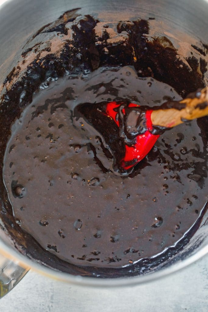 Overhead view of a mixing bowl filled with chocolate brownie batter