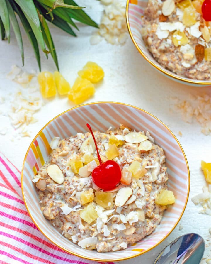 Bircher muesli is a cold breakfast cereal packed with grains and dried fruit that can be customized to your tastes. This Piña Colada Bircher Muesli is packed with whole grains and pineapple and coconut flavors and feels like a tropical vacation first thing in the morning... The only thing missing is the rum!