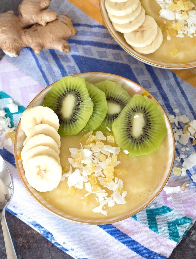 Pineapple Banana Ginger Smoothie Bowl -- This simple-to-make Pineapple Banana Ginger Smoothie Bowl is the perfect way to start your day. Not only is it packed with vitamins and antioxidants, but it's like a vacation in a bowl! | wearenotmartha.com