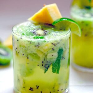 Pineapple Kiwi Mojito -- This Pineapple Kiwi Mojito is made with fresh fruit and no added sugars or other juices. It looks like a fancy cocktail, but you'll be surprised by how simple it is to prepare and enjoy on a hot summer day   wearenotmartha.com