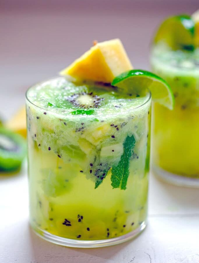 Pineapple Kiwi Mojito -- This Pineapple Kiwi Mojito is made with fresh fruit and no added sugars or other juices. It looks like a fancy cocktail, but you'll be surprised by how simple it is to prepare and enjoy on a hot summer day | wearenotmartha.com