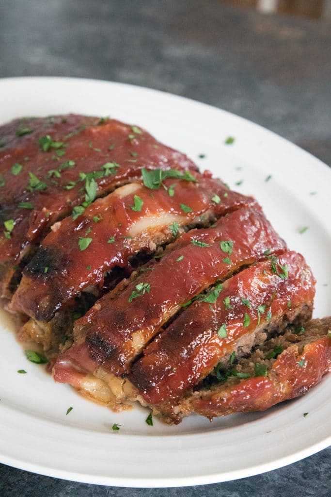 The Pioneer Woman's Favorite Meatloaf -- Meatloaf doesn't get a lot of love. But you'll love this one... It's covered in bacon and a delicious brown sugar ketchup sauce! | wearenotmartha.com