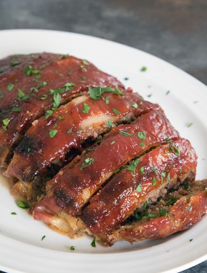 Pioneer Woman's Meatloaf -- Meatloaf doesn't get a lot of love. But The Pioneer Woman's meatloaf will certainly change that. This meatloaf is covered in bacon and a delicious brown sugar ketchup sauce | wearenotmartha.com
