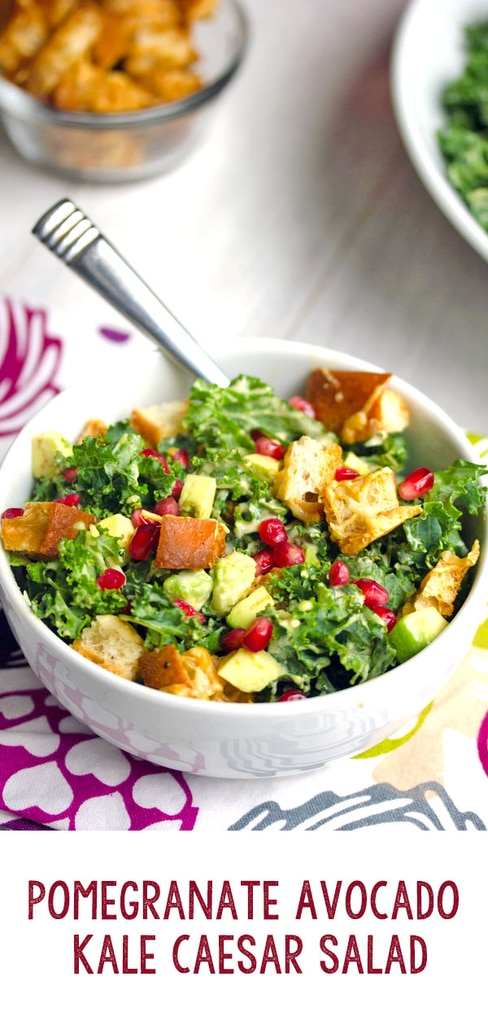 Pomegranate Avocado Kale Caesar Salad -- Caesar salads are nice, but they're even better when made with kale and avocado. This Pomegranate Avocado Kale Caesar Salad with parmesan croutons is the most delicious side or entree salad!   wearenotmartha.com #caesarsalad #kale #kalesalad #pomegranate #avocados #salads