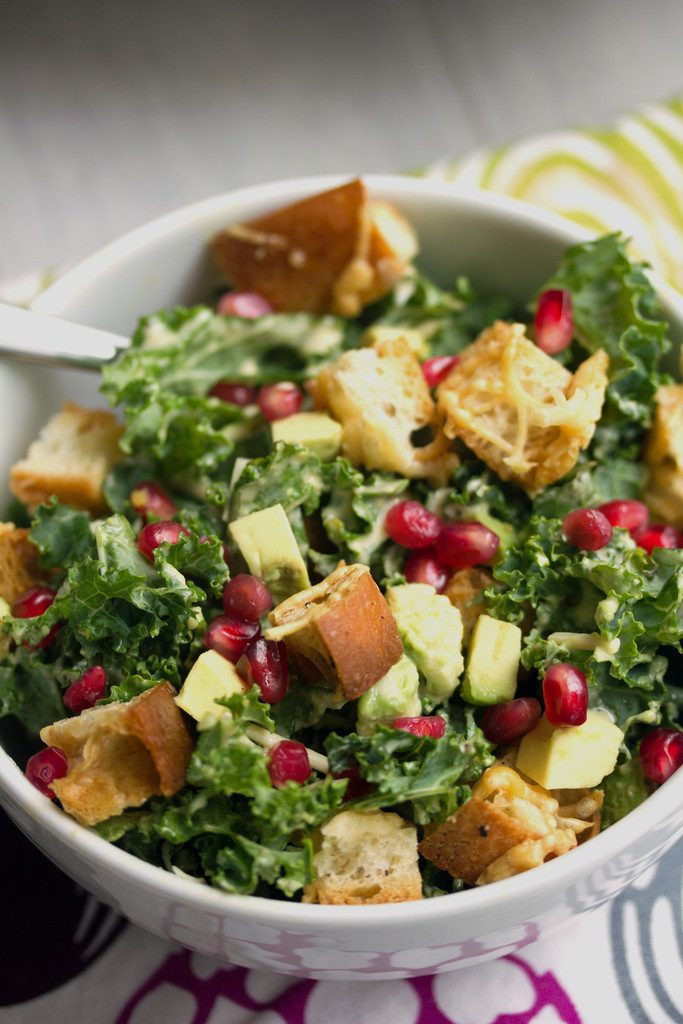 Pomegranate Avocado Kale Caesar Salad -- All my favorite salad ingredients topped with homemade croutons | wearenotmartha.com