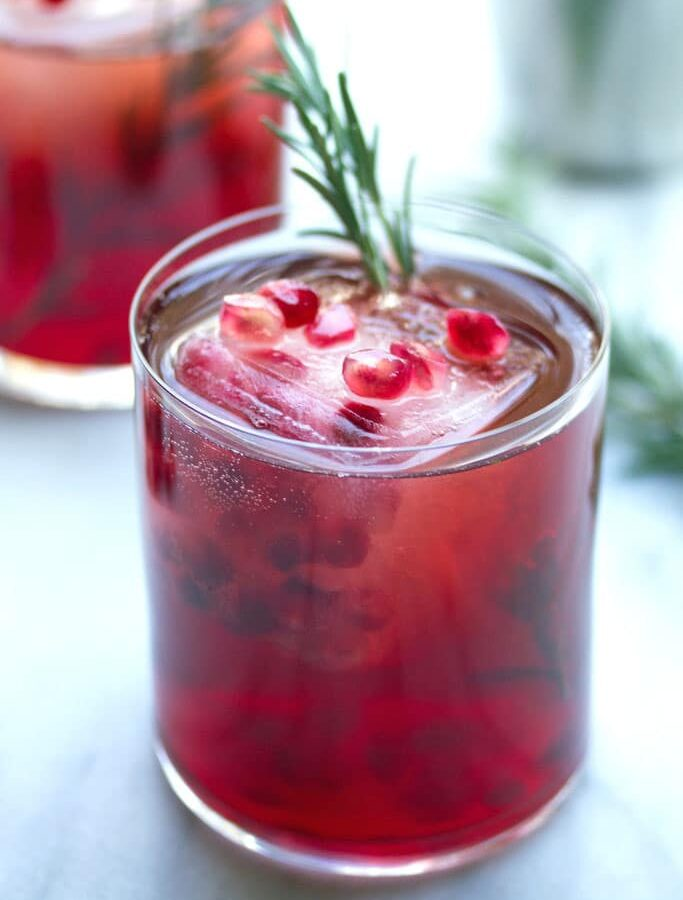 Pomegranate Rosemary Gin Sparkler -- Packed with pomegranate juice, rosemary simple syrup, and gin, this pomegranate and gin cocktail will help you get you through the long winter days | wearenotmartha.com