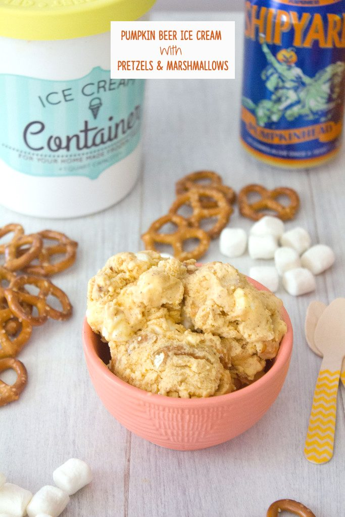Head-on view of a bowl of pumpkin beer ice cream with pretzels, mini marshmallows, wooden spoons, can of pumpkin beer, and quart of ice cream in the background and recipe title at top