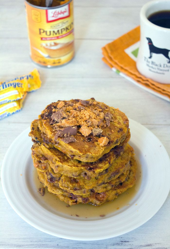 Pumpkin Butterfinger Pancakes -- It doesn't get any better than pumpkin and candy for breakfast! | wearenotmartha.com