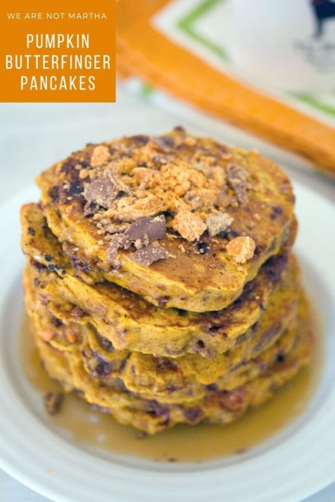 These Halloween candy pancakes are packed with seasonal pumpkin and yummy Butterfingers. Such a fun and indulgent breakfast! | wearenotmartha.com #pancakes #halloween #kidsbreakfasts #candy #butterfingers