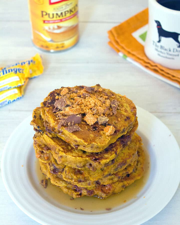 Pumpkin Butterfinger Pancakes -- Who says you can't eat candy for breakfast? These Pumpkin Butterfinger Pancakes combine two of fall's best flavors... Pumpkin and Halloween candy! | wearenotmartha.com