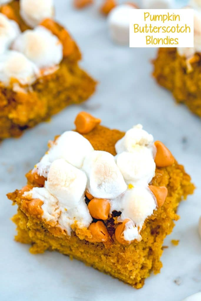 Overhead view of multiple pumpkin butterscotch blondies topped with marshmallows on a white surface with recipe title at top of image