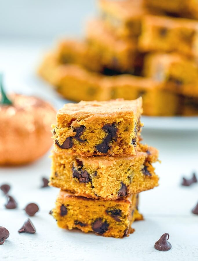 Pumpkin Chocolate Chip Squares -- If you're looking for a go-to pumpkin recipe you'll make over and over, these pumpkin chocolate chip squares are it. I have yet to met a person who doesn't rave about these pumpkin bars every time I make them! | wearenotmartha.com
