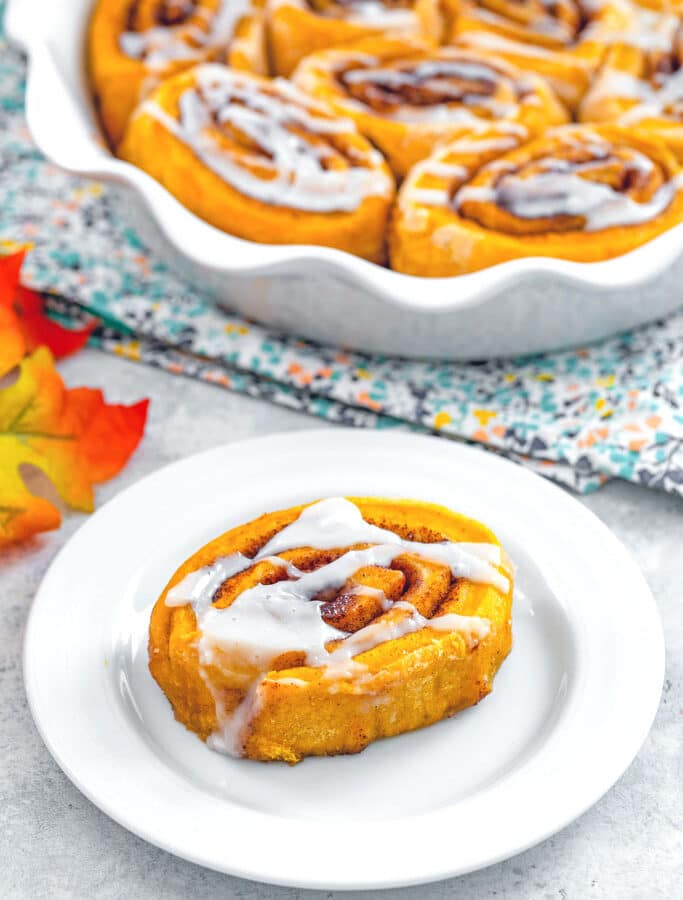 Pumpkin Cinnamon Rolls -- When there's a chill in the air, all I want to do is cuddle up on the couch with a cinnamon roll and a cup of coffee. These Pumpkin Cinnamon Rolls are packed with pumpkin spice flavor and drizzled with a deliciously sweet icing, making for the perfect fall breakfast or afternoon treat   wearenotmartha.com