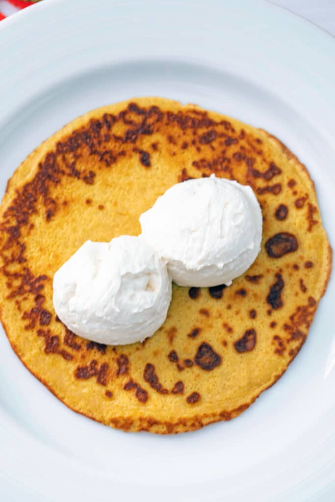 Pumpkin crepe with two scoops of maple cream cheese filling on top