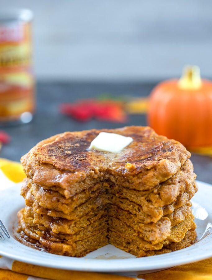 Pumpkin Pancakes -- Made with part whole wheat flour, these Pumpkin Pancakes will blow your mind with how moist and flavorful they are. Your crisp fall mornings are about to get a whole lot cozier with pumpkin pancakes on the menu | wearenotmartha.com