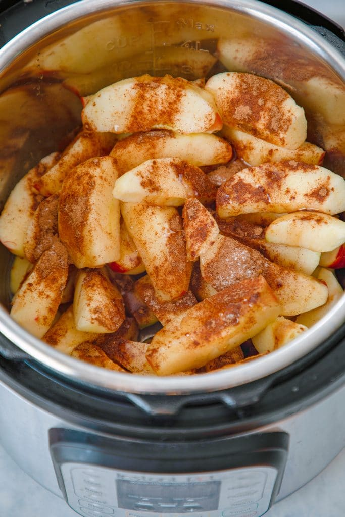 Overhead view of Instant Pot bowl filled with sliced apples and spices