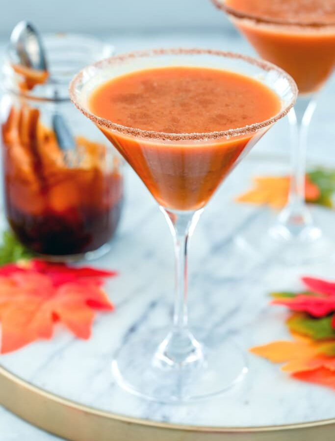 Pumpkin Pie Martini -- This pumpkin pie martini is basically a pumpkin pie in a cocktail glass. Made with pumpkin puree, vanilla vodka, and a pumpkin caramel syrup, it's a pumpkin cocktail that will have you in the fall spirit in no time | wearenotmartha.com