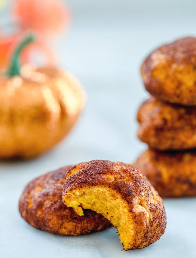 Pumpkin Snickerdoodles -- The only thing better than snickerdoodles are pumpkin snickerdoodles! These cookies are soft and moist and filled with delicious fall flavors | wearenotmartha.com