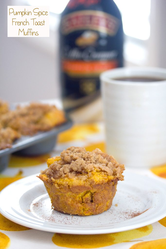 Head-on view of a pumpkin spice french toast muffin on a white plate with muffin tin, cup of coffee, and bottle of coffee creamer in background with recipe title at top