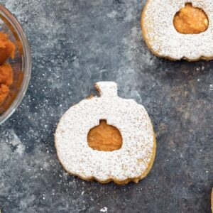 Pumpkin Spice Linzer Cookies -- The perfect fall sandwich cookies filled with pumpkin cinnamon buttercream | wearenotmartha.com