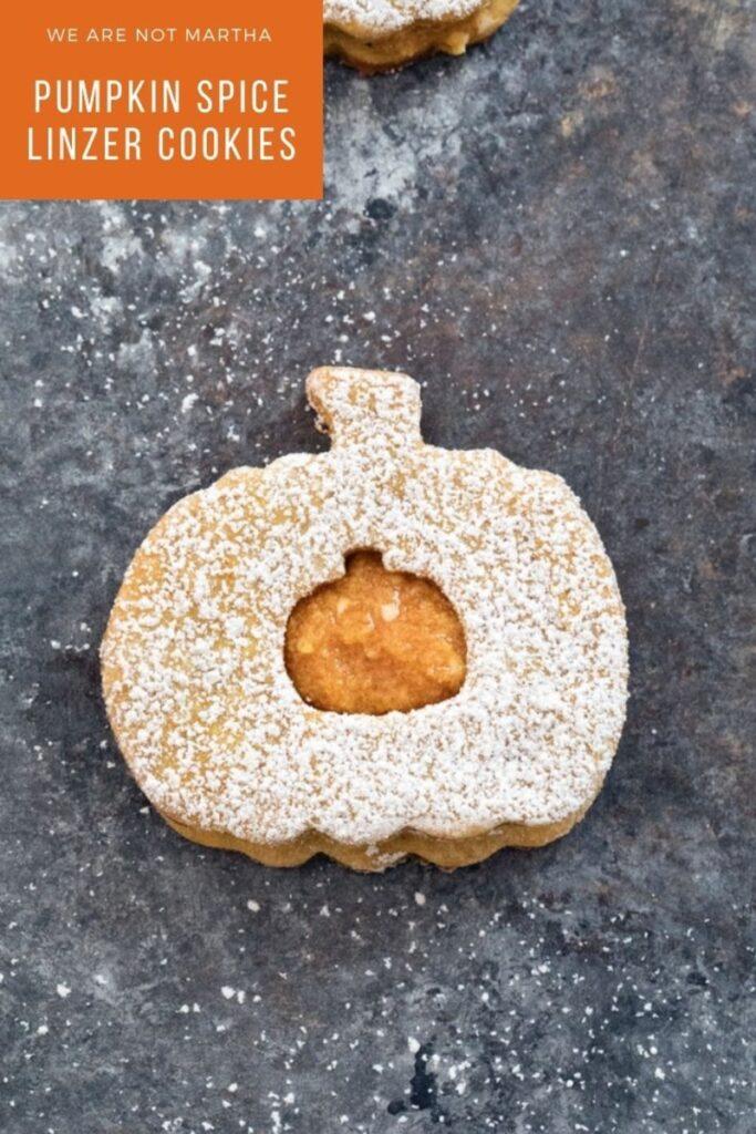 Pumpkin Spice Linzer Cookies are delicious pumpkin sandwich cookies filled with pumpkin cinnamon buttercream | wearenotmartha.com #pumpkinspice #linzercookies #fallcookies #pumpkincookies