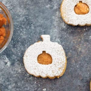 Pumpkin Spice Linzer Cookies -- These Pumpkin Spice Linzer Cookies are filled with pumpkin cinnamon buttercream and are the perfect pumpkin-shaped fall cookie | wearenotmartha.com