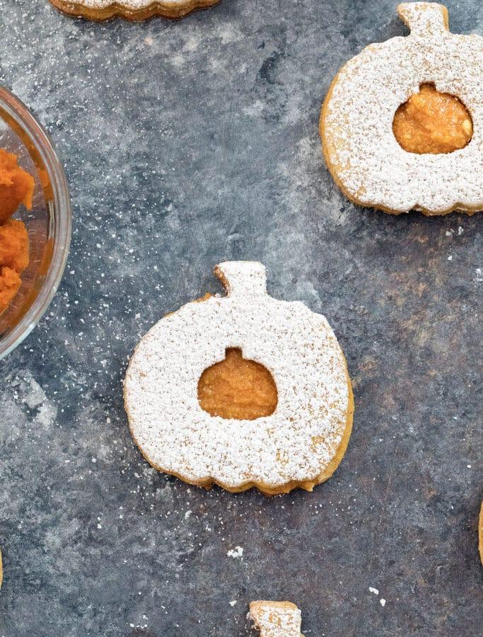 Pumpkin Spice Linzer Cookies -- These Pumpkin Spice Linzer Cookies are filled with pumpkin cinnamon buttercream and are the perfect pumpkin-shaped fall cookie | wearenotmartha.com