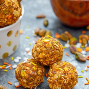 These Pumpkin Spice Pistachio Energy Balls are packed with heart-healthy ingredients like pumpkin, almond butter, pistachios, oats, flaxseed, and chia seeds and are sure to give you an extra little boost of energy and happiness any time of day! | wearenotmartha.com #pumpkinspice #energyballs #energybites #proteinsnacks #healthysnacks #easysnacks