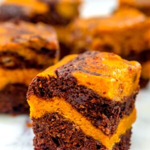 Pumpkin Swirl Brownies -- You can't beat desserts that combine pumpkin and chocolate in the fall and these Pumpkin Swirl Brownies mix them in the prettiest way | wearenotmartha.com
